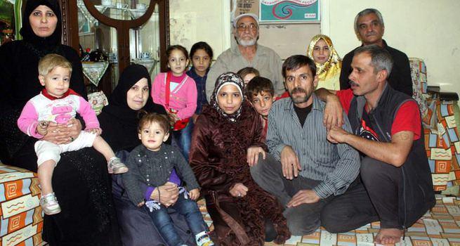 Emekli maaşıyla 8 kişilik Suriyeli aileye bakıyor